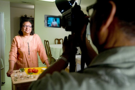 Alex, Manjula's husband, shoots, edits and publishes the videos online. Here's a glimpse at one of their shooting sessions in 2010. (src: business-opportunities.biz)